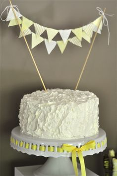 Super-sweet bunting cake topper! #projectnursery #babyshower #grayandyellow