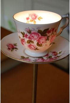 Teacup lamp (inspiration only) - love this idea! with a tealight inside? Couldn't decide if I should pin it to outdoor boards (would make a nice pathway light) or party decor or candles or shabby chic / cottage style  ... in the end putting it on upcycle dishes