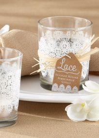 A wisp, a swirl, a knot, a space: The vintage charm of handmade lace. Tied with a few strands of natural raffia, this lacy glass tealight holder has a nostalgic look and adding candle glow to lace makes the room light up.  Style 20152NA. #davidsbridal #laceweddings