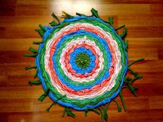 using old t shirts and a hula hoop. web page has tutorial! pretty cool.