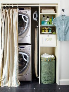 A space-saving stacked washer and dryer in this closet-turned-laundry area leaves plenty of room to install shelves for storage. If your laundry closet lacks a door, like this one, conceal it with a cute, colorful shower curtain suspended from a shower rod. The curtain solution hides the otherwise visible laundry room, a definite plus when guests visit. Doing this!