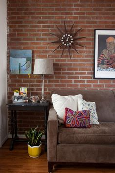 Brick wall, neutral couch