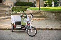 A fresh take on wedding day transportation! This couple used a pedicab!