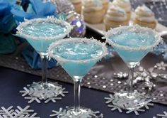 Jack Frost Martini  1 cup pineapple juice 1/2 cup (4 ounces) light rum or vodka 1/2 cup (4 ounces) blue curacao 1/2 cup (4 ounces) cream of coconut (not coconut milk) 10 to 12 ice cubes Shredded coconut, for garnish  Mix together the juice, liquors, cream of coconut and ice; strain into martini glasses. Rim glasses with the shredded coconut. Makes 4 drinks.