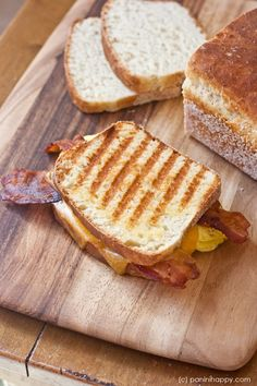 Bacon, Egg and Cheddar English Muffin Panini ...get the #recipe at http://www.paninihappy.com (c) Kathy Strahs