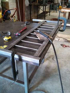 Welding up a bed frame.