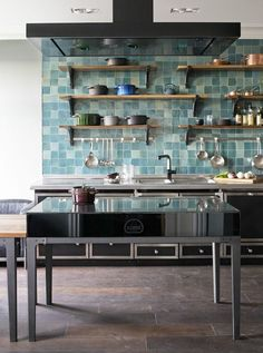 Le Cornue + blue ceramic tile + open shelving