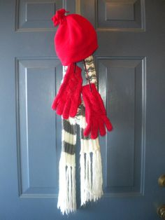 Wanted something besides a wreath for my front door for this winter.....just use whats in your closet.  Why didn't I think of this before... <3