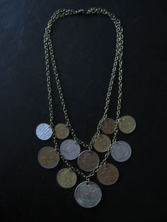 Foreign coins from travels - LOVE THIS IDEA SO MUCH
