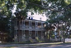 """The William Joseph Thomas House, Beaufort, SC. Built in 1909 overlooks the Beaufort River. Located in """"The Point"""", a distinguished neighborhood in historic Beaufort . Architecture is Victorian Period built in the Beaufort style with paired fluted Doric order columns spanning the facade of double tiered verandas. Situated between the Wallace House (1907) & the Lewis Reeve Sams House (1852)"""