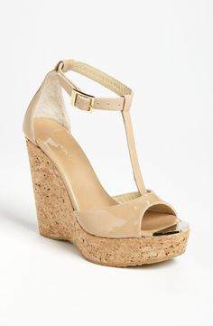 Gorgeous nude wedge sandals from Jimmy Choo. Would totally wear these with dresses or jeans.