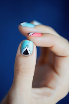 Paint nails blue, let dry and put tape on nail to form a triangle. Paint triangle white & remove tape. Add a black triangle inside the white one and put dots around the edges.