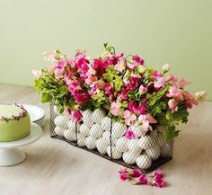 This adds a new meaning to an Easter Basket. Eggs, wire basket and sweet peas, great combination.