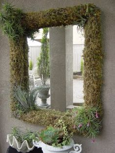 DIY Moss Framed Mirror - hot glue floral foam onto an old mirror and cover it in moss. wrap the whole thing in chicken wire and use a staple gun to attach it to the wood frame.