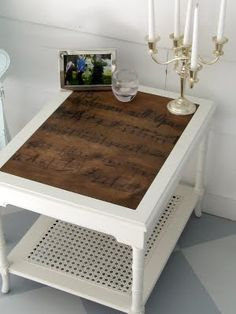 A scrap of French Opera - Side Table @Mandy Cox Webb a variation of this would be super fun in your music room!