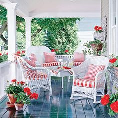 wicker porch...love that red and white!