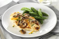 Zesty Marinated Chicken recipe - Mushrooms and basil add fresh flavor to chicken marinated in zesty dressing. Melted cheese tops things off nicely for a tasty entrée that can be part of a healthy eating plan.