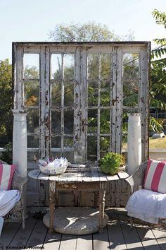 Re  purpose old door into desk screen - 21 DIY Re purpose Old Door Ideas rustic doors and columns outdoors. Sweet!)