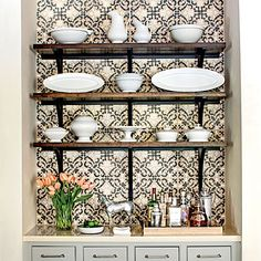 Kitchen with open shelving and antique ironstone china.
