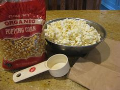 The easiest microwave popcorn EVER!  Pops in under 2 minutes, and you can sprinkle your toppings right in the bag and shake!
