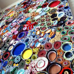 Lee Gainer's work is organic ...created from many bits of man-made materials ...a variety of recycled - upcycled - materials such as fabric, paper, felt, foil, caps, carpet, metal, plastic, styrafoam, dried paint, beads, padding and cardboard, that have been hand-rolled into circles and swirls.