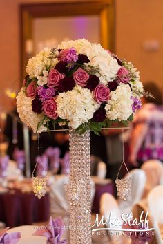 #wedding reception decorations #centerpieces #tablescapes #reception details #Michigan wedding #Mike Staff Productions #wedding details #wedding photography #wedding dj #wedding videography www.mikestaff.com... #tall centerpieces #purple flowers #white flowers