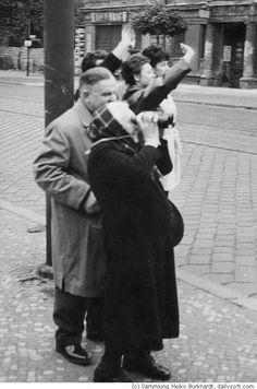 Berlin Wall 1961-West Berliners waving and watching their relatives in East Berlin