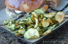 Zucchini Chips.  Thinly sliced zucchini soaked in salt water then flash-fried!  Yum!