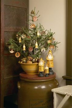 Christmas tree in a yellow ware bowl