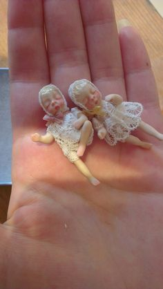 Porcelain Miniature ooak Baby Doll. via Etsy.