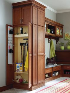 Dog leash storage! The Utility Organizer Drop Zone by Thomasville Cabinetry. Includes magnetic dry erase board, pencil holder, charging station, key hooks, and coat hooks.