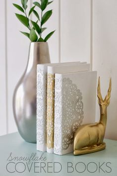 Books covered in white with a doily covering the spine look lovely