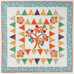We love the charming style of this quilt design by Heidi Pridemore of The Whimsical Workshop.  This was featured earlier this spring by Quilt Magazine and they offer the pattern as a free PDF download, along with tons of others!  She uses the Daydreams collection by P&B Textiles for this quilt. http://www.freequiltpatterns.info/free-pattern---enchanted-forest-quilt-by-heidi-pridemore.htm