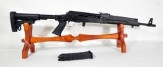 """Saiga AK-Variant Rifle .223 Rem / 5.56 Nato 16"""". Russian-made semi-automatic rifle manufactured by Izhmash, in the AK-47 style. Features a pistol grip with storage compartment, 6-position telescopic stock, and adjustable folding rear sight. $629.00"""