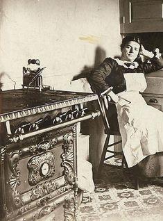 Victorian woman in her kitchen