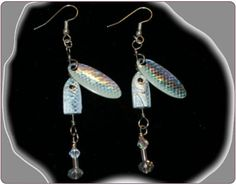 http://diginanchors.com/EarringsAlure_GreySpinner - Dangling earrings made with beautifully grey finished, high quality lures.  Added to each fishing lure is sparkling clear crystals and beads to match the color of the lure.  The unique earrings are 3 and 1/4 inches long . All earrings are hung on stainless steel earwires of either gold or silver plating.