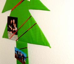 Christmas Card display Christmas Tree - A little twist to the typical display board.  I'm thinking you can do christmas presents shapes with this idea too!  From http://www.thepinkapronblog.com (image links to the appropriate blog page)