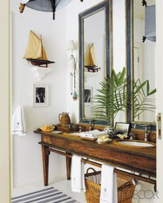 long console, tall mirrors, rusticity, beachy - would love this bathroom