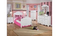 Exquisite Sleigh Bedroom Set - decorative embossing and detail. Perfect for your little princess, to make her feel oh so Royal.  -by Ashley Furniture-