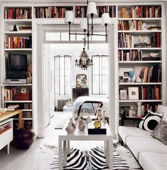 Books can frame a space. See more images from not so black and white on domino.com the doors, light fixtures, domino galleri