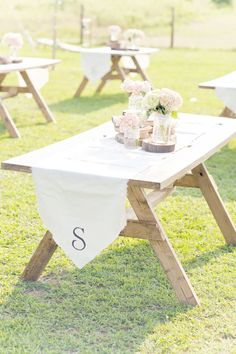 picnic style tables complete with a monogram  Photography By / glassjarphotography.com, Wedding Design By / asouthernaffairevents.com