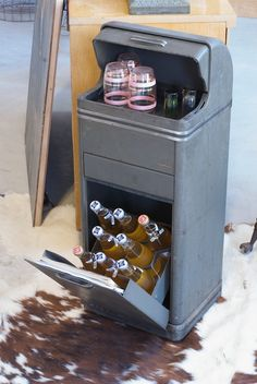 Originally a record-player cabinet. Now adapted to a new (better?) use.  Glad to see a High Life or two in there.