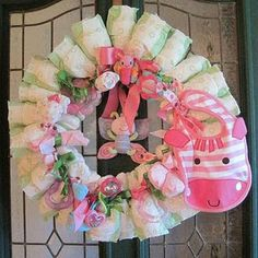 Pink and Green baby diaper wreath.  Great decoration and gift idea.