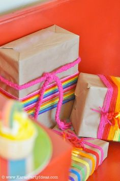 CUTE gift wrapping idea! Rainbow Themed birthday party with SO much inspiration! Cute printable party pack! Via Karas Party Ideas KarasParty Ideas.com #rainbow #birthday #party #ideas #cupcakes #printables #supplies #cake #cupcakes #favors #drinks