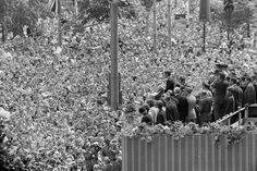 Ich bin ein Berliner Thousands watch Kennedy give a speech on June 26, 1963, in West Berlin, Germany. Kennedy's support of a democratic West Germany was central in the Cold War, a conflict that defined the Kennedy administration.