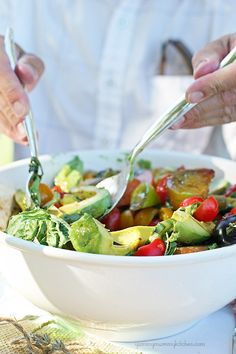 Delicious heirloom tomato, cucumber, and avocado salad. Perfect late summer salad