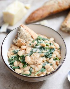 Creamy Parmesan Bean Stew with Spicy Greens
