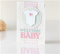Welcome the new bundle of joy in your life with this card featuring a sentiment created with the Cricut® Extreme Fonts cartridge.