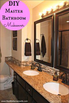 Complete DIY remodel on a master bathroom including - cabinets, tube, tile, shower, backsplash, fixtures, etc. {www.lifeofthefarmerswife.com}