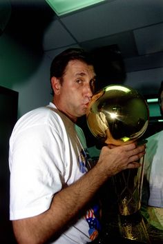 Rudy T kissing the trophy.    For the latest Houston Rockets news and updates, visit www.rockets.com.